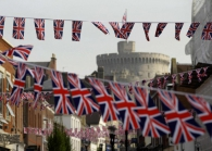 Union flag the wedding of Britain's Prince  are put up by workers on a street near Windsor Castle in Windsor, England, Thursday, April 21, 2011 ahead of the royal wedding.  Britain's Prince William is due to marry Kate Middleton on April 29.  (AP Photo/Matt Dunham)